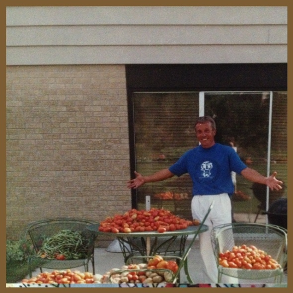 My dad amidst his bountiful tomatoes.