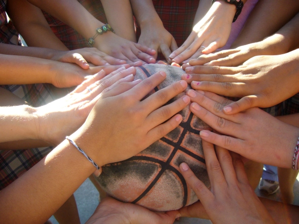 We all placed our hands around the basketball before leaving.