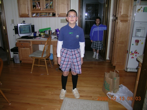 Middle school Ben, hands in pocket, rockin' those plaid pants on Tacky Day.